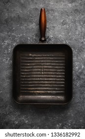 Empty old grill pan on dark stone background top view