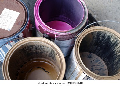 Empty and Old Paint Cans Ready to be Disposed