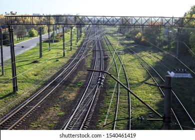 Empty old railroad tracks top view. Railway metal track crossing