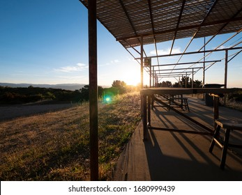 An empty old rustic shooting range in the early morning as the sun comes up.