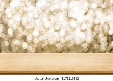 Empty old rustic wood table top with blur sparkling gold bokeh abstract background,panoramic banner for display or montage of product,Holiday seasonal concept backdrop