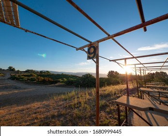 An empty old uncovered rustic shooting range in the early morning as the sun comes up.