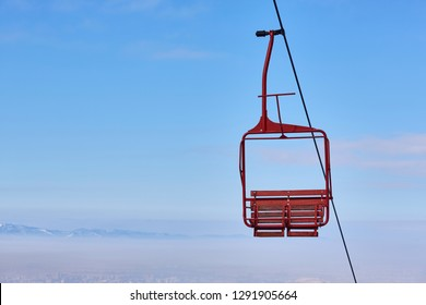 Empty old wooden chairlift against blue sky. Brasov, Romania.