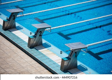 Empty olympic swimming pool with clear blue water