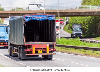 empty open door lorry truck on uk motorway in fast motion