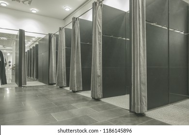 Empty open fitting room in clothing store.