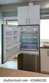 Empty open fridge in the kitchen.