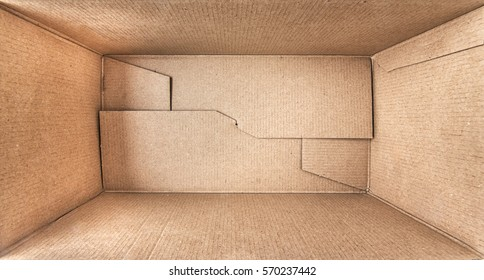 Empty open rectangular cardboard box close up. - Shutterstock ID 570237442