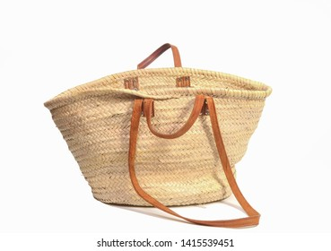 Empty open wicker bag on white