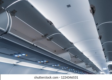 Empty of opened luggage compartment on the commercial airplane