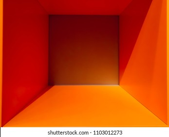 Empty orange room space, interior for design and decoration - abstract background. square box with blank inner space. Empty room interior perspective view. Photobox inside.