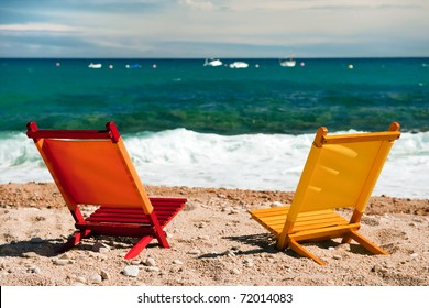 empty orange and yellow chairs at the tranquil beach