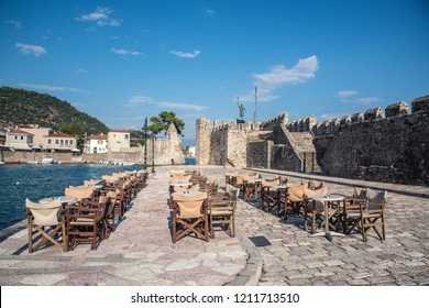Empty outdoor cafe by the harbour, Nafpaktos, Mainland Greece
