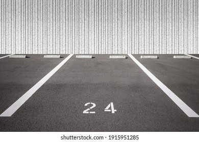 Empty outdoor car Parking Spaces and concrete wall