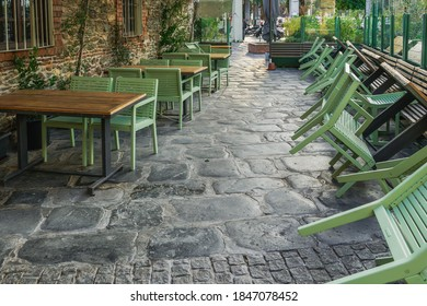 Empty outdoors tables as Coronavirus measures affect business & life in Greece. Closed bar restaurants chairs at the city center in Thessaloniki, after government tries to prevent COVID-19.