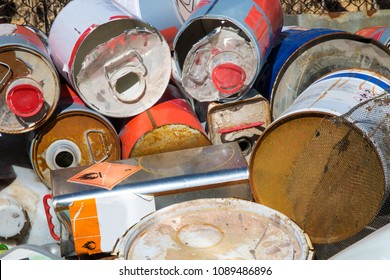 Empty paint cans in a pile