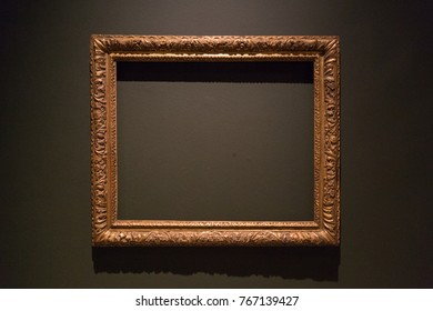 An empty painting frame in a museum