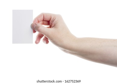 Empty paper card in woman hand isolated on white background