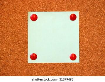 empty paper on cork board
