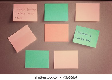 Empty paper sheets on fridge door, vintage effect