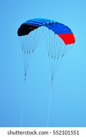 Empty parachute in the sky. Space for text.