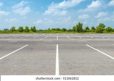 Empty parking lot against a beautiful blue sky