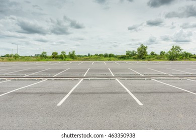 Empty parking lot against a beautiful sky