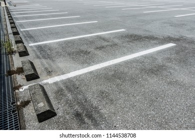 Empty parking lot with parking barrier, Vacant Parking Lot, Parking lane painting on floor, copy space