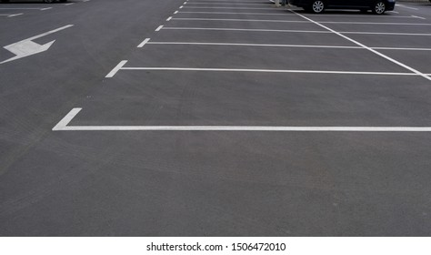 Empty parking with clear markings and arrows indicating the direction of movement. Modern car parking. Marking on asphalt road.