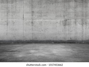 Empty parking lot, interior background with gray concrete wall and asphalt flooring, abstract photo texture