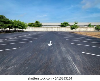 Empty parking lot,Parking lane outdoor in public park on blue sky background.