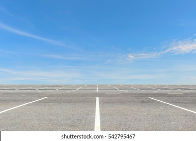Empty parking lot on blue sky background