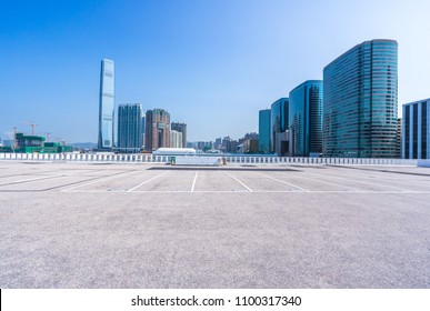 empty parking square with city skyline in hongkong china