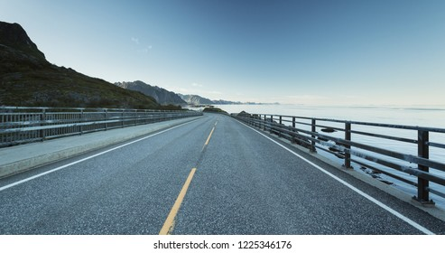 An empty part of the Atlantic highway and European corridor E10 near the fishing town of Reine on the Lofoten islands, Norway.