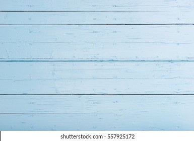 Empty pastel blue wood background with copy space.