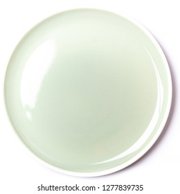 Empty pastel green plate, isolated on white background