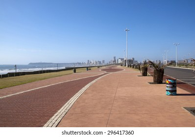 empty paved walkway promenade with hotels in distance at durban's golden mile