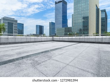 empty pavement and modern buildings in city