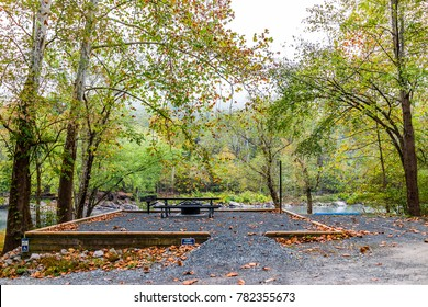 Empty permit required campground site for disabled people with car spot and river, picnic table, fire pit in Grandview Sandbar West Virginia