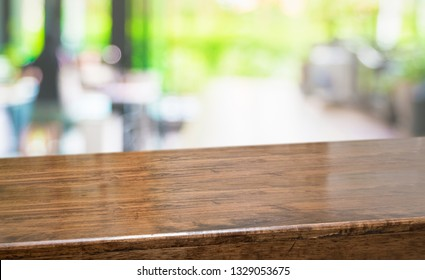 Empty perspective hardwood table with blur kitchen in garden background bokeh light,Mock up for display or montage of product,Banner or header for advertise on online media