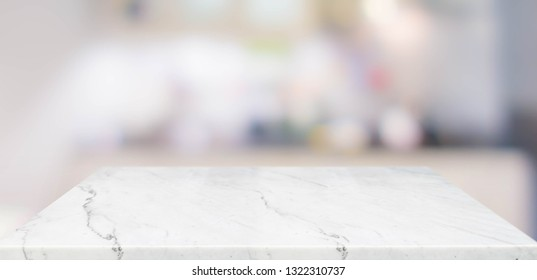 Empty perspective marble table top with blurred home kitchen background.Mock up template for display or montage of your design,Banner for advertise of product