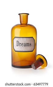 Empty pharmacy medicine bottle with the word dreams on white background
