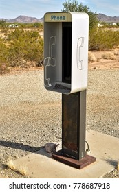 empty phone booth in desert outdated technology