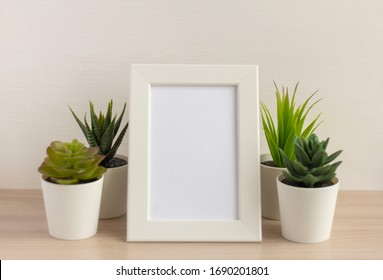 An empty photo frame on a table or shelf with a copy of the space