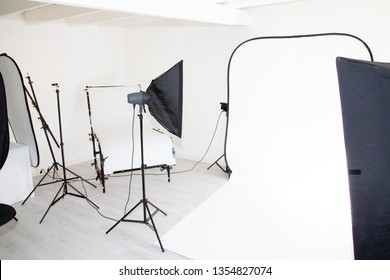empty photo studio background with photography lighting equipment