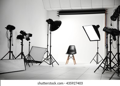 Empty photo studio with lighting equipment