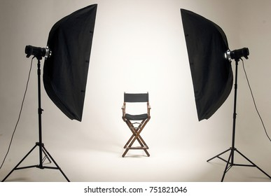 Empty photo studio with lighting equipment. Space for text. Vacant chair. The concept of selection and casting. Screensaver for your desktop.