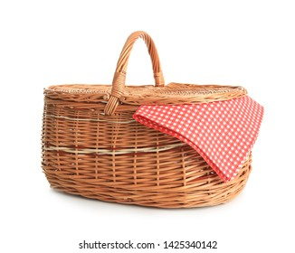 Empty picnic basket with checkered cloth isolated on white