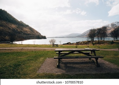 Empty picnic table by Loch Eil, Fort William, Scotland, on a clear spring day.