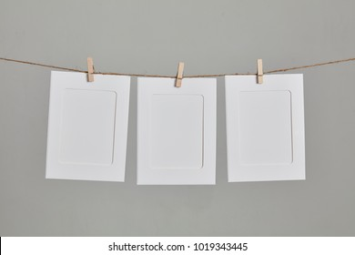 empty picture frame hanging on rope